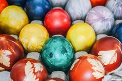 Painted colorful Easter eggs are in the cells in the box. Background. royalty free stock image