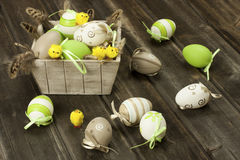 Painted Colorful Easter Eggs on wooden surface Stock Photos