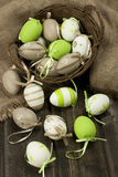 Painted Colorful Easter Eggs on wooden surface Royalty Free Stock Photos