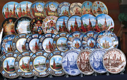 Painted colorful souvenir plates with the symbol of the Moscow Stock Photos