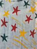 Painted colorful stars on linen fabric Stock Photo