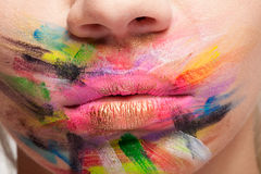 Painted colors on lips and mouth Stock Images
