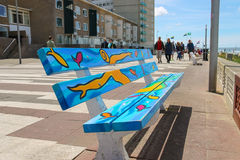 Painted colourful bench on the waterfront of North sea. Zandvoort, the Netherlands- June 20, 2015: Painted colourful bench on the waterfront of North sea stock photography