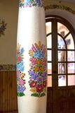 Painted column in church decorated with a hand painted colorful flowers, Zalipie, Poland. ZALIPIE, POLAND - AUGUST 3, 2018: Painted column in church decorated royalty free stock photos