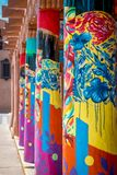 Colorful columns with blue flowers and abstract designs in Santa Fe New Mexico. Painted columns with colorful designs in the downtown plaza in Santa Fe New stock image