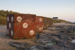 Painted Concrete squares on Bamburgh Beach. Northumberland. Stock Photos