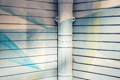 The painted corner. Graffiti painted wall corner and gutter Royalty Free Stock Photos