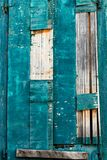 Painted damaged wooden surface closeup, background/ texture. royalty free stock image