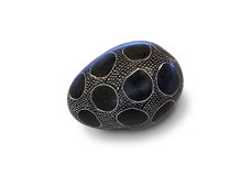 Painted decorated stone egg Stock Images