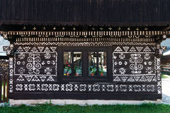 Painted decorations on wall of log house in Cicmany, Slovakia Stock Photography