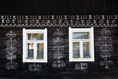 Painted decorations on wall of log house in Cicmany, Slovakia Stock Images