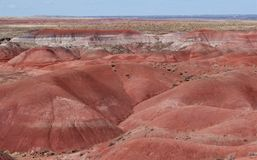 Red ochre sandstone layers eroded in v shaped valleys royalty free stock photo