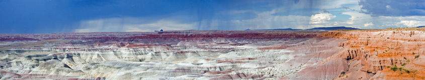 Painted Desert Storm panorama. True wide panorama of a rare rainstorm over the Hope Indian Reservation and the famous Painted Desert of northern Arizona Royalty Free Stock Photography