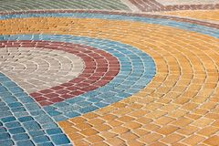 Painted in different colors is figured pavement of stone Stock Photos