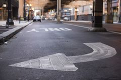 Painted directional arrow on street Stock Photography
