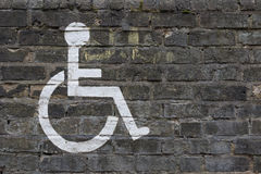 Painted Disabler Sign. Disabler Sign Painted on Brick Wall royalty free stock photos