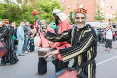 Painted and disguised musicians during the celebration of the feast of Saint George and the dragon. stock image