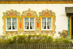 Painted dog on a painted house in Bavaria Royalty Free Stock Images