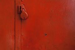 Painted door with red color with lock Royalty Free Stock Photos