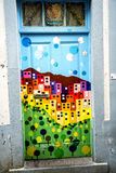 Painted door on Santa Maria Street in Funchal Madeira. This is a narrow street in the old town of Funchal. It is full of Restaurants and cafes, but is chiefly stock image