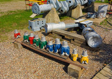 painted drill heads lined up at fort nelson, bc Royalty Free Stock Photo