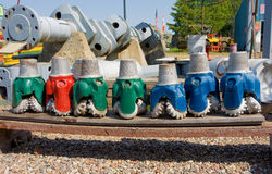 Painted drill heads lined up at fort nelson, bc Stock Photo