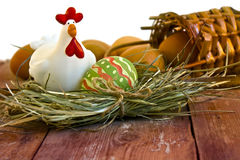 Painted Easter egg and decorative chicken Royalty Free Stock Photos