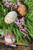 Painted Easter egg and grass with cherry branch Royalty Free Stock Images