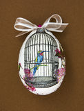 Painted Easter egg with the hummingbird in the cage Stock Images