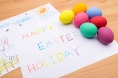 Painted easter egg and little kid drawing Stock Photography