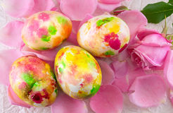 Painted Easter egg on pink rose petals Stock Photos