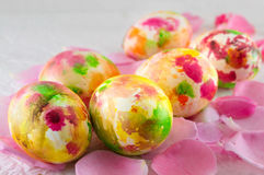 Painted Easter egg on pink rose petals Royalty Free Stock Image