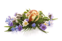Painted easter egg and spring flowers. Hand painted easter egg and spring flowers composition royalty free stock image