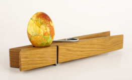Painted Easter egg standing on the clothes pin Royalty Free Stock Photos