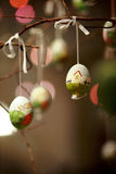 Painted Easter eggs. Colorful easter eggs decorated on tree stock image