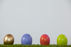 Painted Easter eggs arranged on grass Stock Images