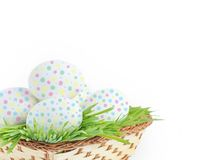 Painted Easter eggs in basket Stock Image