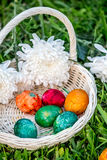 Painted easter eggs in basket Stock Photo