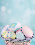 Painted Easter Eggs in a Basket Royalty Free Stock Images