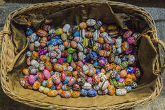 Painted Easter eggs in basket. Painted eggs are decorated by various techniques before Easter.The imitation of painted eggs are made of wood on the picture stock images