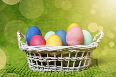 Painted Easter eggs in a basket. Easter background. Spring religious holiday easter concept.  Royalty Free Stock Image