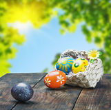 Painted Easter eggs in a basket on the table Stock Image