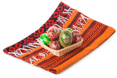 Painted Easter eggs in basket on towel Stock Photo