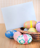 Painted Easter Eggs and Blank Envelope Royalty Free Stock Photography