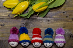 Painted Easter eggs . A bouquet of yellow tulips. Royalty Free Stock Photos