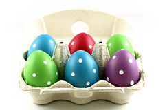 Painted Easter eggs in carton. Colorful painted Easter eggs in open carton or box, white background Royalty Free Stock Photography