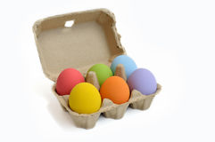 Painted easter eggs in carton on white background. Painted easter eggs in carton  on white background Royalty Free Stock Image