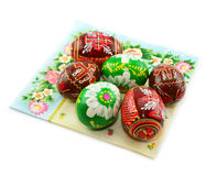 Painted Easter eggs on colored napkin isolated. Group of painted Easter eggs on colored napkin isolated on a white background Stock Photography