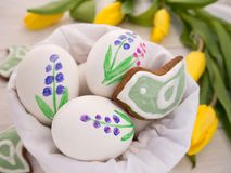 Painted Easter eggs and cookies Royalty Free Stock Photography