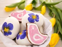 Painted Easter eggs and cookies Royalty Free Stock Image